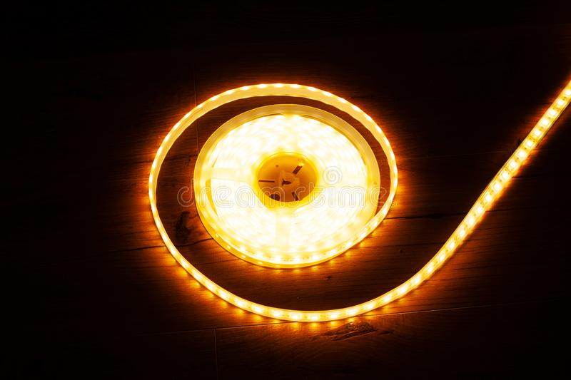 A coil of diode tape for lighting, yellow decorative led strip. Close up stock image