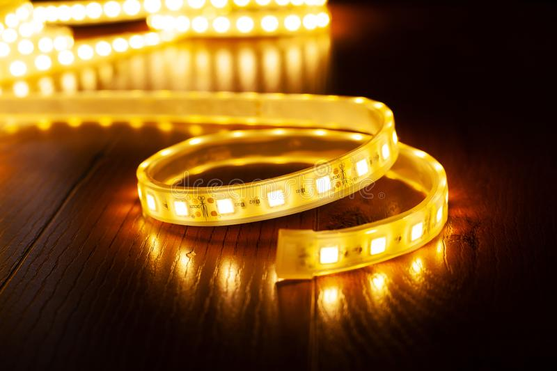 A coil of diode tape for lighting, yellow decorative led strip. Close up royalty free stock photography
