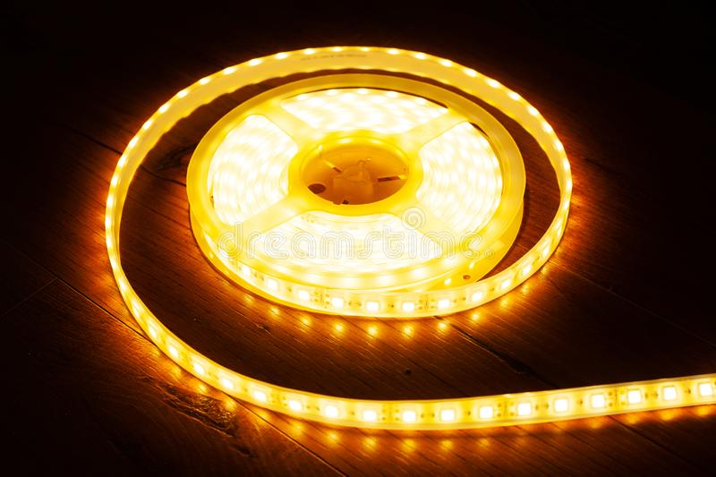 A coil of LED decorative strip to illuminate niches in the house. Close up stock photo