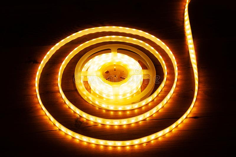 A coil of LED decorative strip to illuminate niches in the house. Close up royalty free stock images