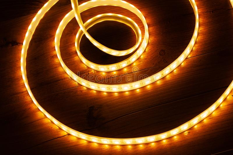 A coil of LED decorative strip to illuminate niches in the house. Close up royalty free stock photography