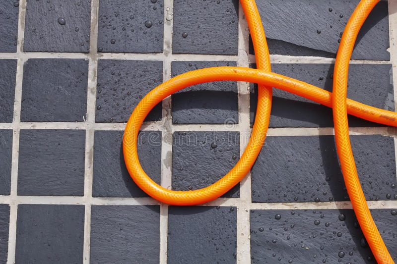 Download Coiled Hose On Tiles Royalty Free Stock Photos - Image: 26560268