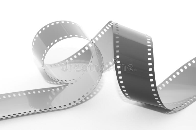 Coiled 35mm film strip stock photography