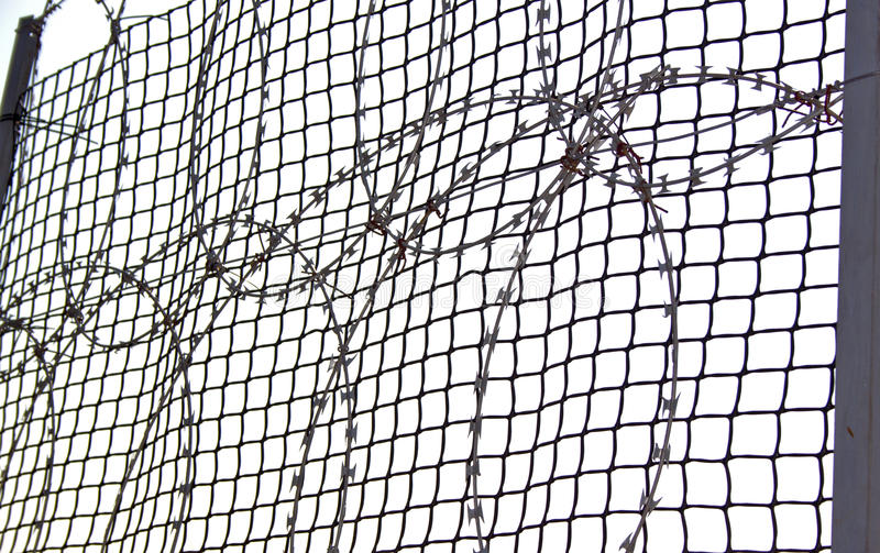 Coiled Razor Wire On An Bonnex Fence Stock Image - Image of shield ...