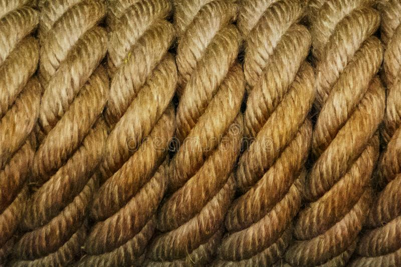 Coiled rope. Eye-catching repetitions. This decorative element caught my attention while I was in a terrace of a leisure place. A simple boat line rolled over royalty free stock photography