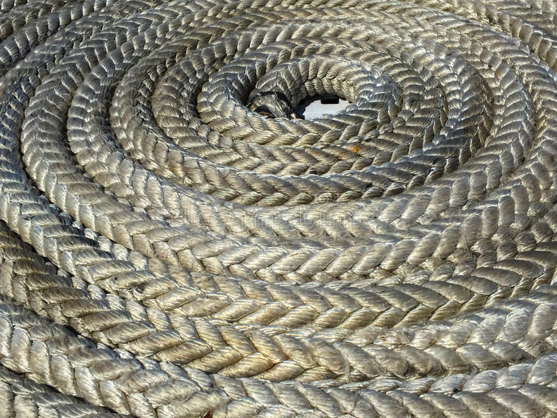 Coiled rope on ship deck royalty free stock image