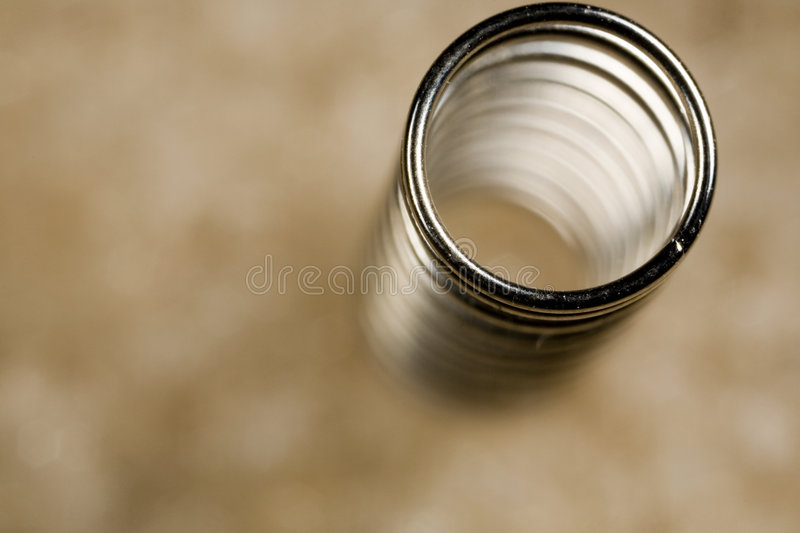 Coiled spring viewed from top stock photos