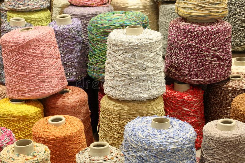 Coils and spools of fine colored wool thread for the creation of. Many coils and spools of fine colored wool thread for the creation of handmade sweaters royalty free stock photos