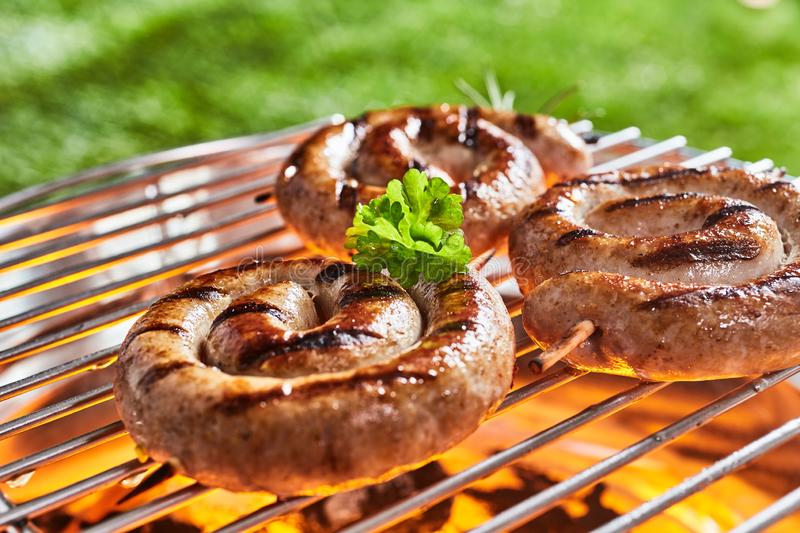 Coils of succulent beef sausage on a barbecue stock photo