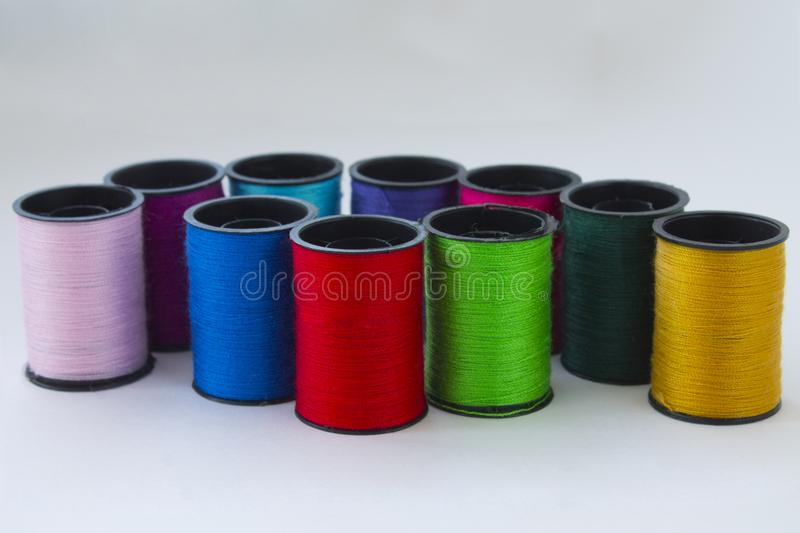Coils of threads. Sewing thread on a light background royalty free stock photography