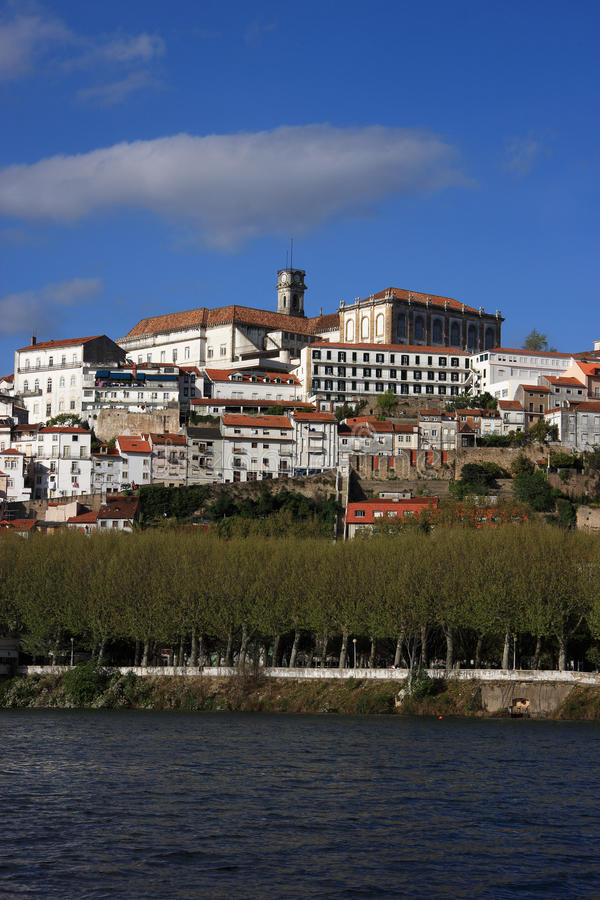 Coimbra 1. Portugal Coimbra - famous historical university city towers over the Mondego River stock image