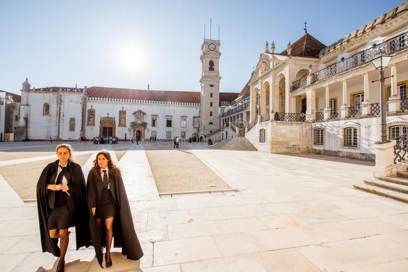 Coimbra city in Portugal. COIMBRA, PORTUGAL - September 26, 2017: View on the courtyard of the oldest university with students in black uniform in Coimbra city royalty free stock image