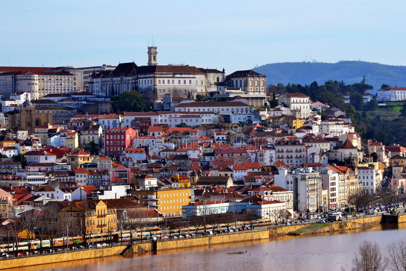 Coimbra city university and Mondego river view. Coimbra cityscape with view to the university clock and the Mondego river. The historic university, one of the stock photos