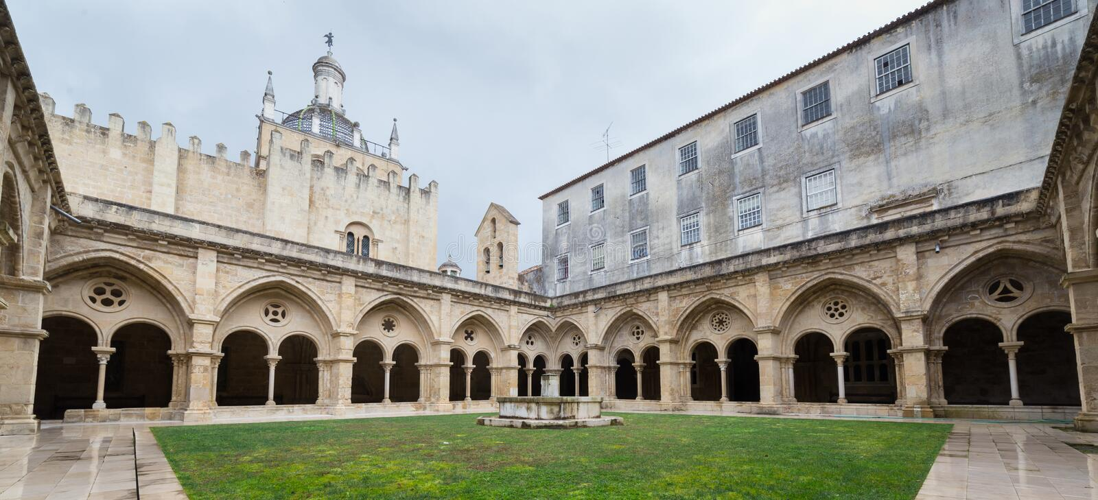 Old Cathedral Se Velha in Coimbra, Portugal. COIMBRA, PORTUGAL - FEBRUARY 28, 2017: Gothic cloister of the Old Cathedral Se Velha in Portuguese in Coimbra royalty free stock images