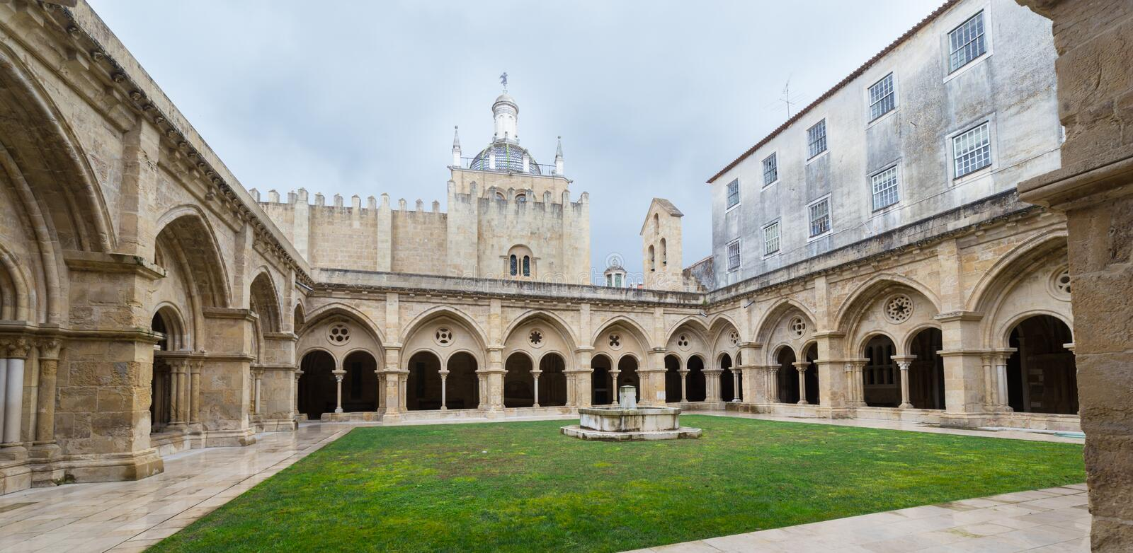 Old Cathedral Se Velha in Coimbra, Portugal. COIMBRA, PORTUGAL - FEBRUARY 28, 2017: Gothic cloister of the Old Cathedral Se Velha in Portuguese in Coimbra stock images