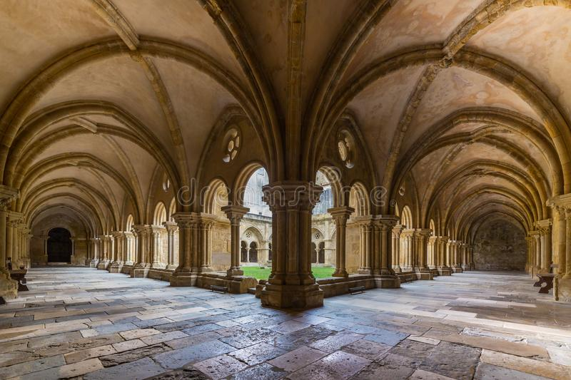 Old Cathedral Se Velha in Coimbra, Portugal. COIMBRA, PORTUGAL - FEBRUARY 28, 2017: Gothic cloister of the Old Cathedral Se Velha in Portuguese in Coimbra stock image