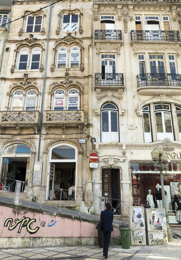 Coimbra. PORTUGAL - MARCH 13,2014: Narrow Street with ancient houses in Old Town, , Portugal royalty free stock photo
