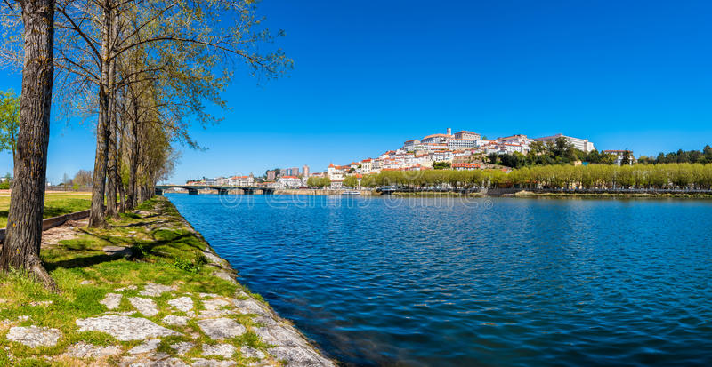 Coimbra Portugal and Mondego River. Panoramic view on Coimbra Portugal and Mondego River in early spring royalty free stock photo