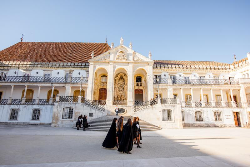 Coimbra city in Portugal. COIMBRA, PORTUGAL - September 26, 2017: View on the courtyard of the oldest university with students in black uniform in Coimbra city stock photos