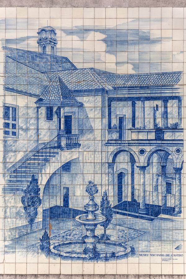 Traditional tile panel collection, painted with famous monuments, in the Coimbra city region, on exhibition in downtown Coimbra. Coimbra / Portugal - 04 04 2019 royalty free stock photo