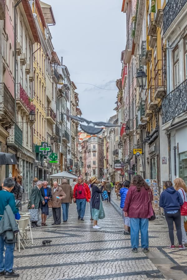 View at the Ferreira Borges Street, Downtown street in Coimbra city, persons and classic buildings. Coimbra / Portugal - 04 04 2019 : View at the Ferreira Borges royalty free stock image