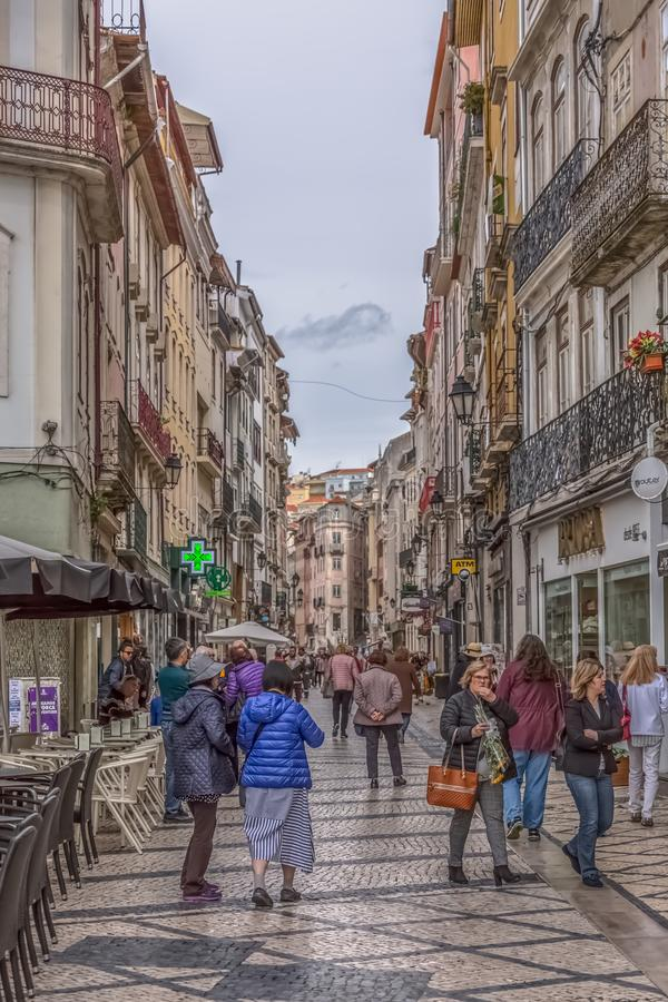 View at the Ferreira Borges Street, Downtown street in Coimbra city, persons and classic buildings. Coimbra / Portugal - 04 04 2019 : View at the Ferreira Borges royalty free stock photography