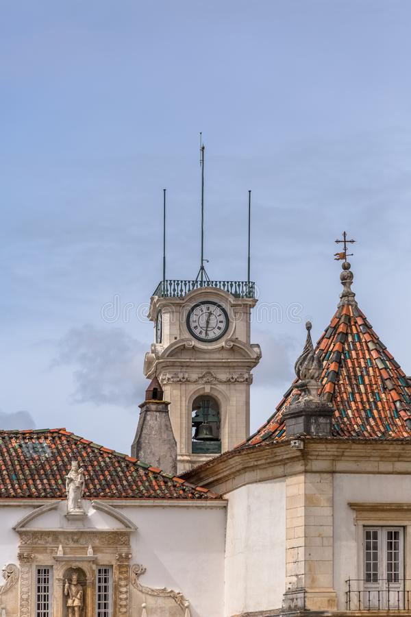 View of the tower of the University of Coimbra, classic architectural structure with masonr and other classic buildings around, in stock photos