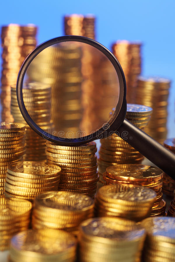 Coin. Group of coins and magnifying glass royalty free stock photo