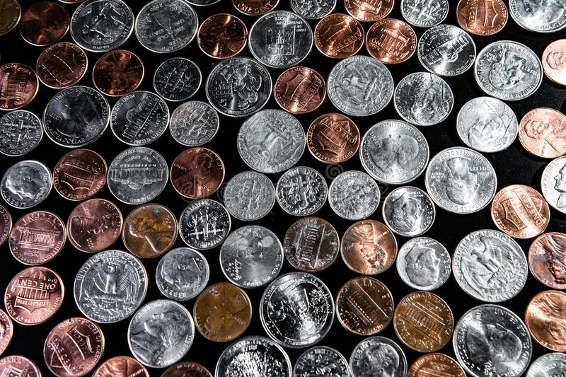 Golden and silver american dollar coins background. Coin background. Pennies/Quarters/ Cents royalty free stock photography