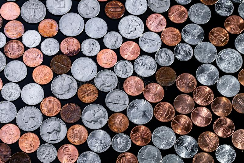Golden and silver american dollar coins background. Coin background. Pennies/Quarters/ Cents royalty free stock images