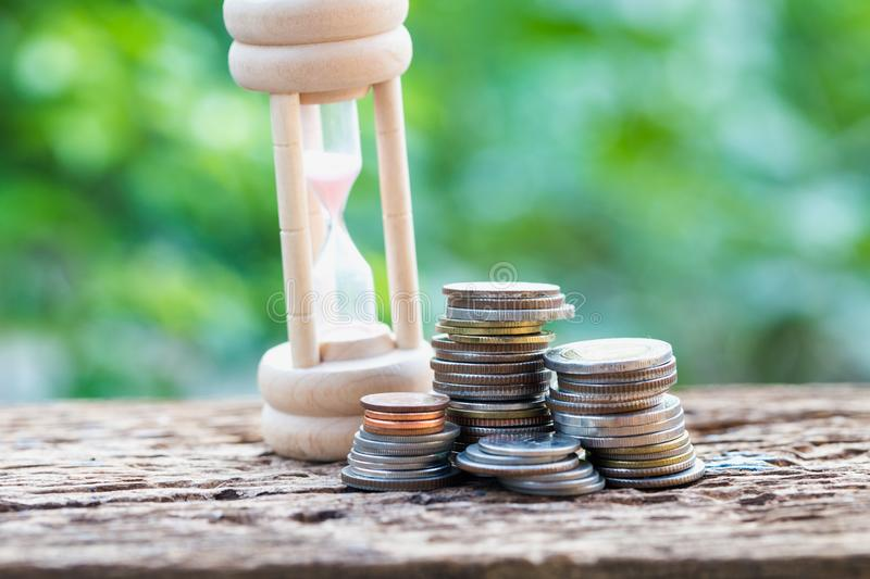 Coin calculator and clock, Idea of value to finance and saving money. royalty free stock image