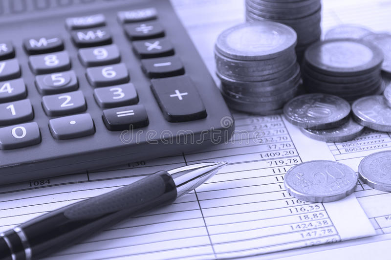 Download Coin, A Calculator, A Pen On The Business Papers Royalty Free Stock Image - Image: 23932806