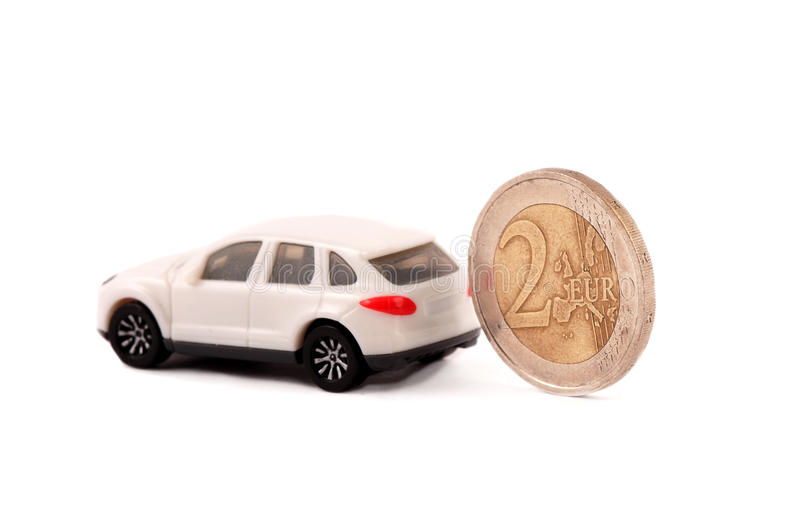 Coin and a car. Two Euro coin and a toy car royalty free stock image