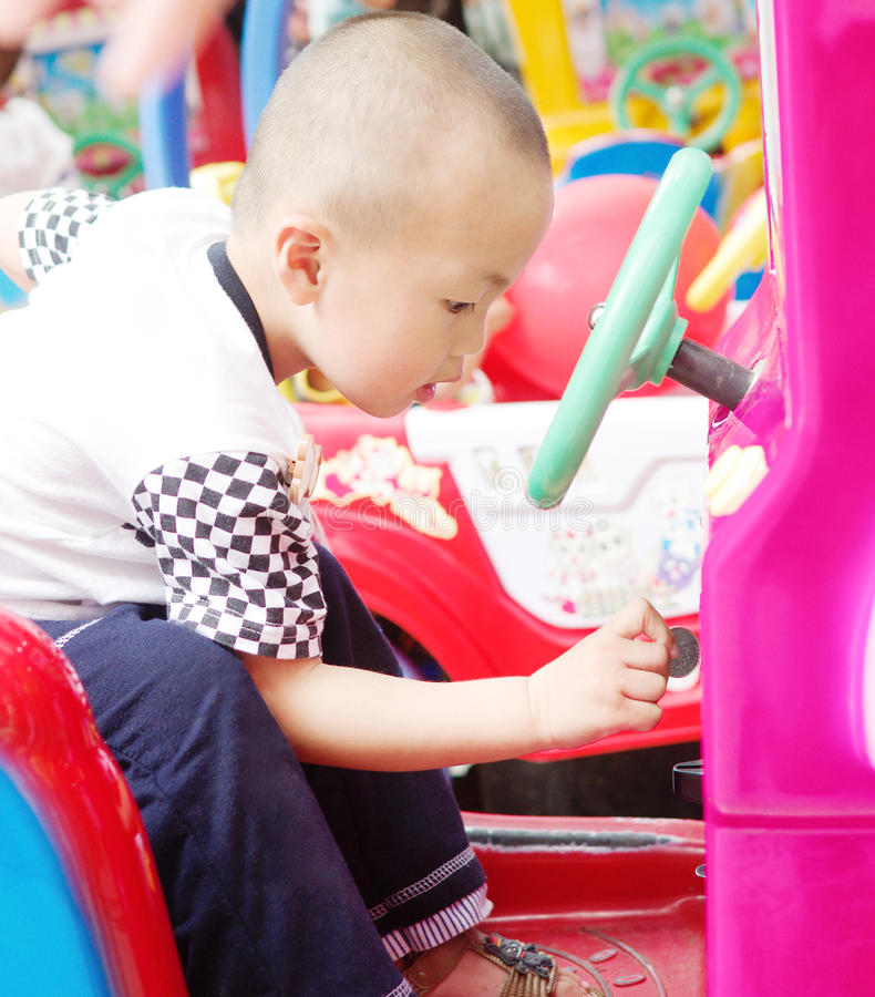 Coin. A child playing a game car royalty free stock image