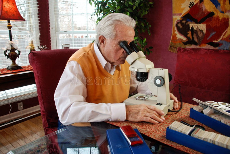Download Man Viewing Old Coin Under A Microscope Stock Photo - Image: 8732340
