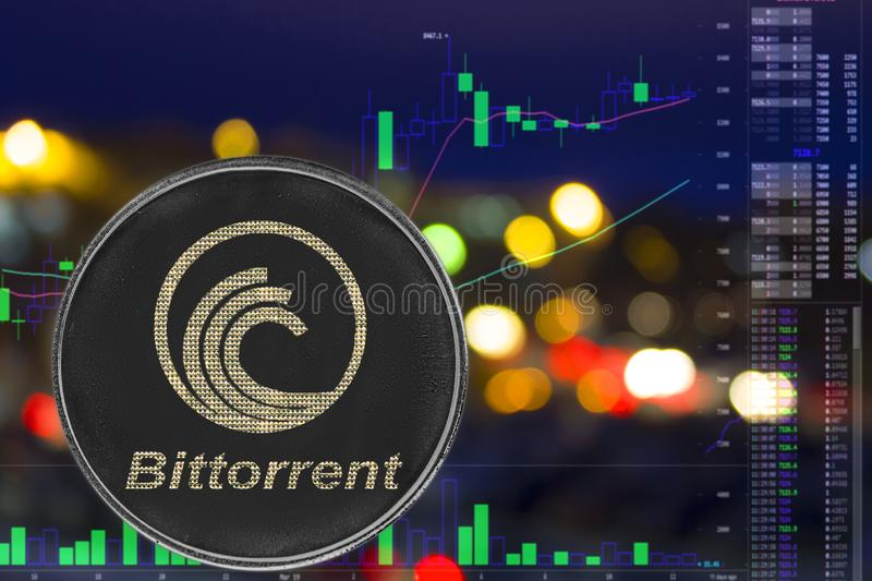 Coin cryptocurrency bittorrent on night city background and chart. BTT royalty free stock photos