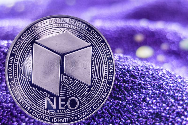 Coin cryptocurrency Neo on modern neon background. stock image
