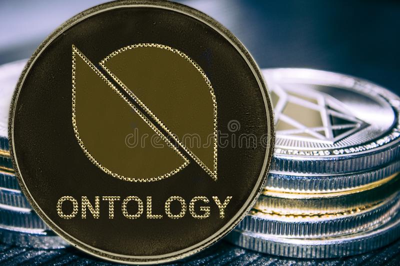 Coin cryptocurrency Ontology on the background of a stack of coins. ONT. Coin stock photo