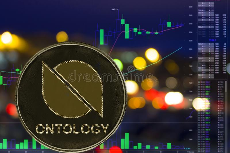 Coin cryptocurrency Ontology ONT on night city background and chart. Coin cryptocurrency ONT Ontology on night city background and chart stock photo