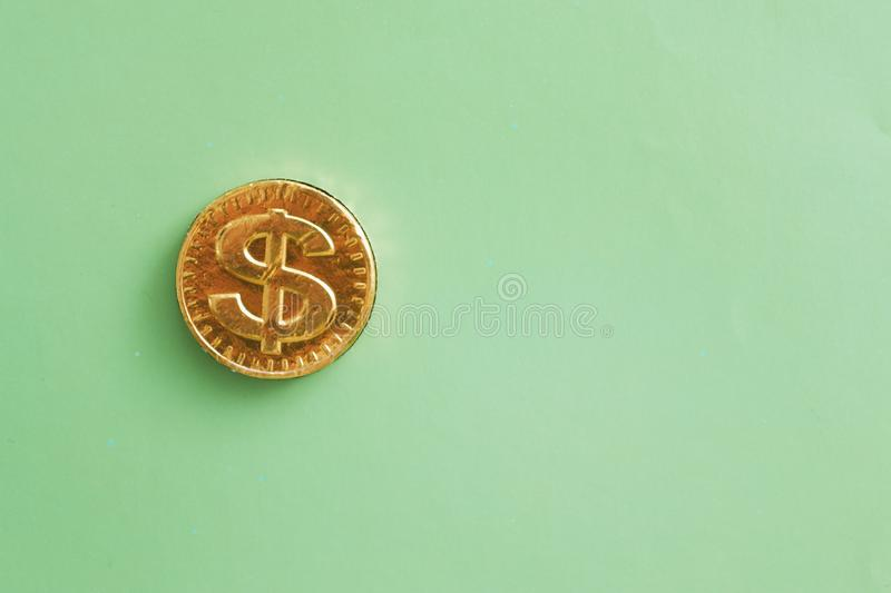 Coin dollar on a green background. Financial concept.  stock photo