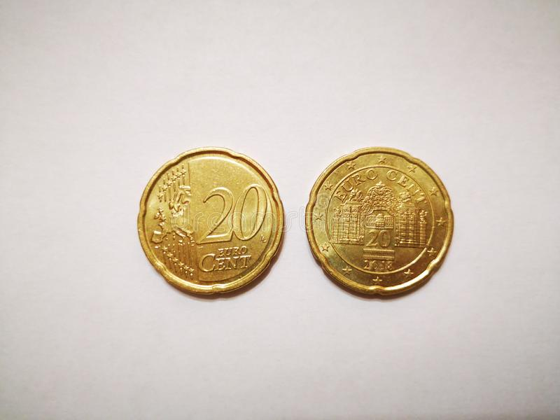 Coin 20 EURO Cent, obverse and reverse. Coin 20 EURO Cent, made of copper, lies on a white background, obverse and reverse stock image