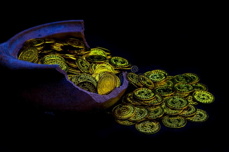 Coin gold in lady hand on lots stacking golden coins in broken jar white background, Money stack for business planning investment royalty free stock image