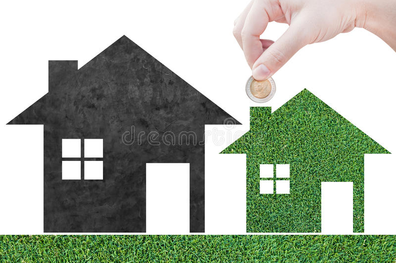 Coin Hand holding house icon in nature as symbol of mortgage. Dream house on nature background, isolated on white background stock image