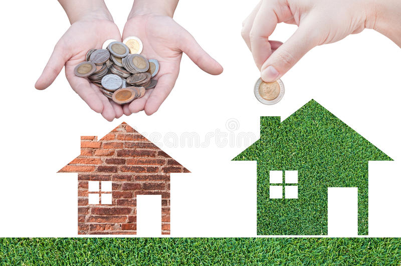 Coin Hand holding house icon in nature as symbol of mortgage. Dream house on nature background, isolated on white background royalty free stock photos