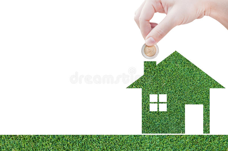 Coin Hand holding house icon in nature as symbol of mortgage, Dream house on nature background. And space for your text royalty free stock image