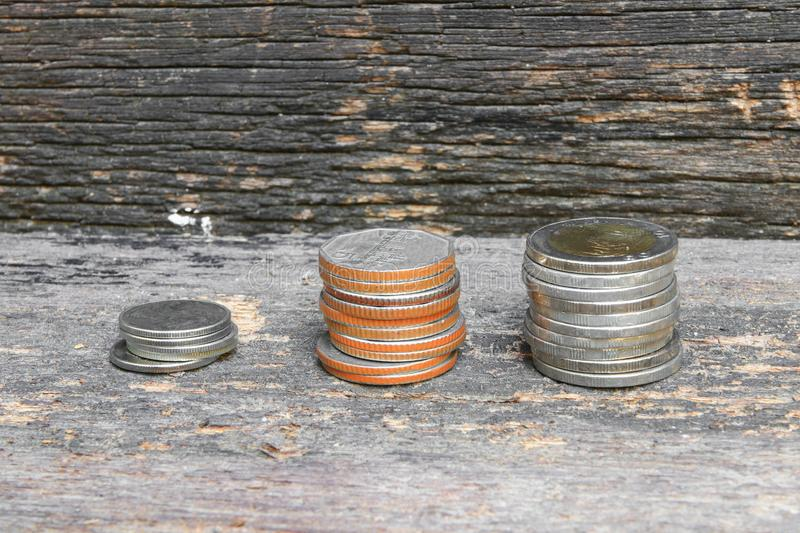 Coin money stacks on wooden floor background royalty free stock image