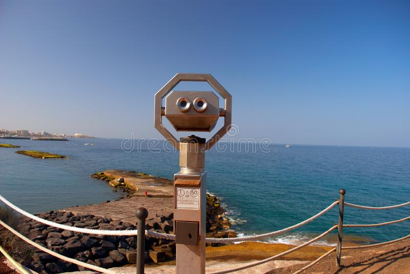 Coin operated binocular