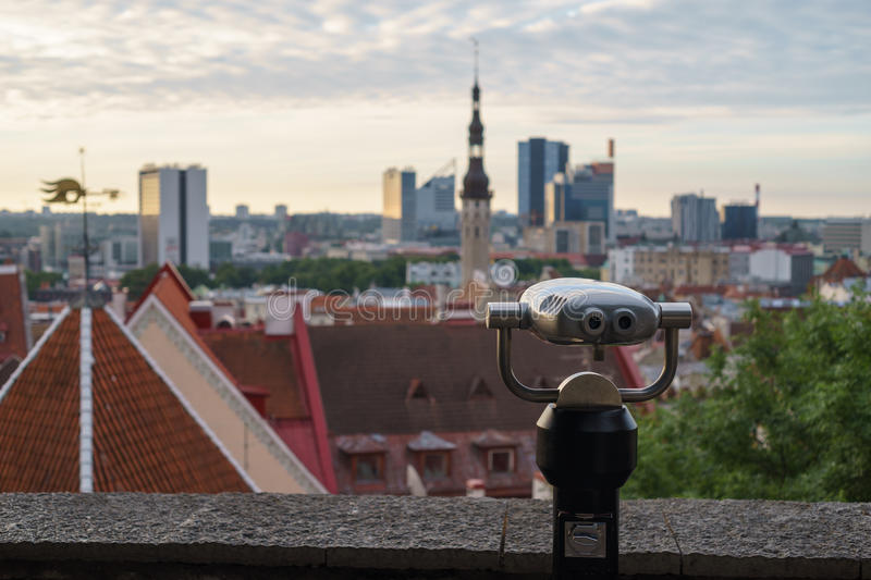 Coin-operated binoculars overlooking city. Coin-operated binoculars at viewing platform overlooking the morning panorama of the city stock photo