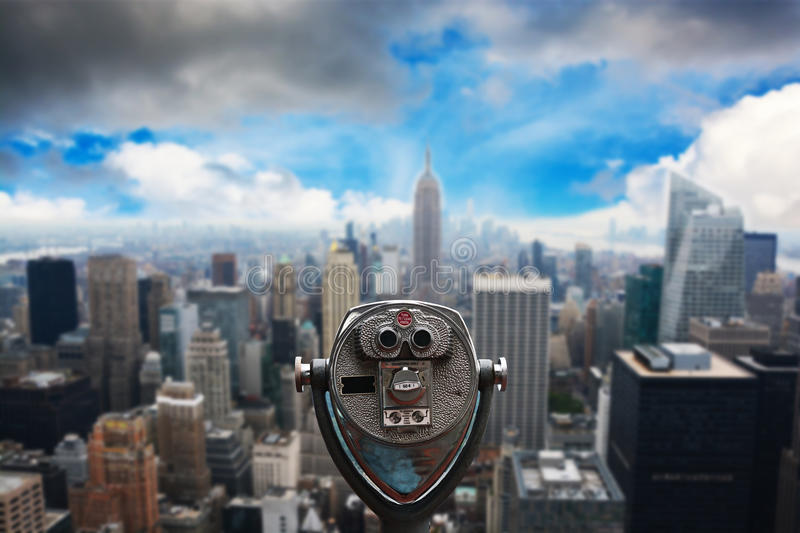 Coin operated binoculars on Top of the Rock, against Empire State Building – Manhattan, New York stock photos