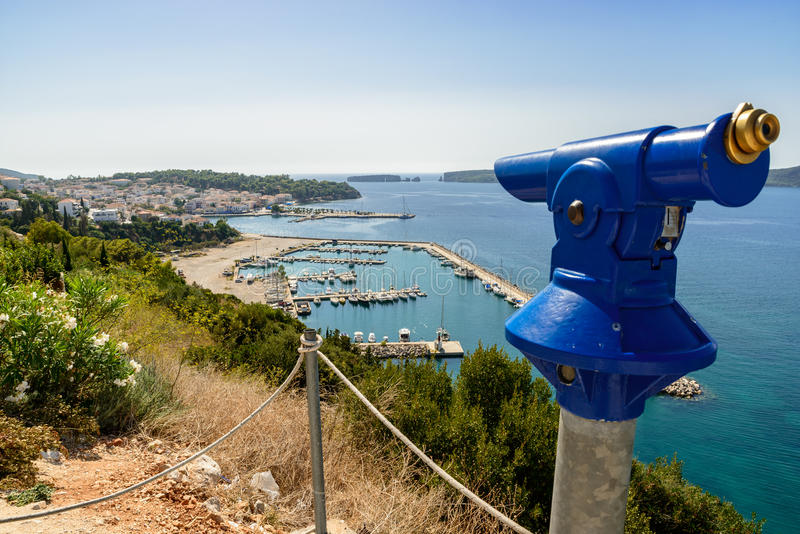 Coin operated telescope at Pylos. Coin operated telescope at an elevated position with a panoramic view of Pylos, the marina, Navarinou bay and Sphacteria island royalty free stock image